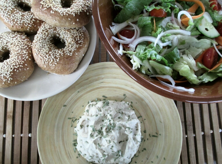 vegan cashew cream cheese with salad and sesame bagels