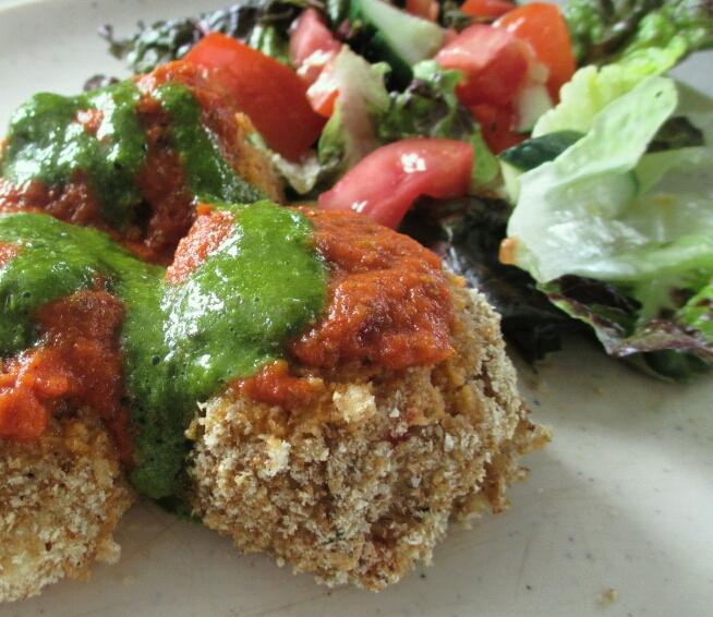 leftover risotto balls with fresh basil dressing and chilli tomato sauce. vegan risotto balls, rice balls