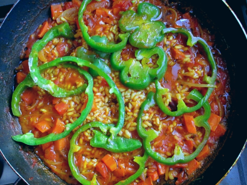 vegan vegetable paella cooking on stove top
