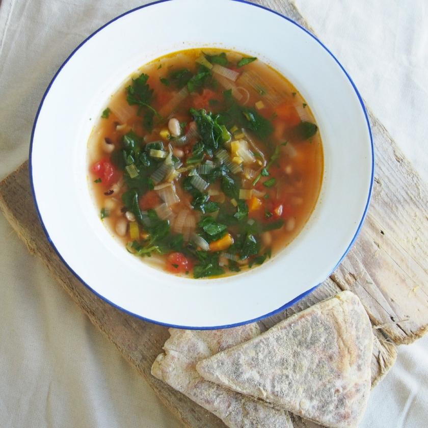 Hominy, cachupa black eyed pea tomato broth stew homemade vegan potato farls